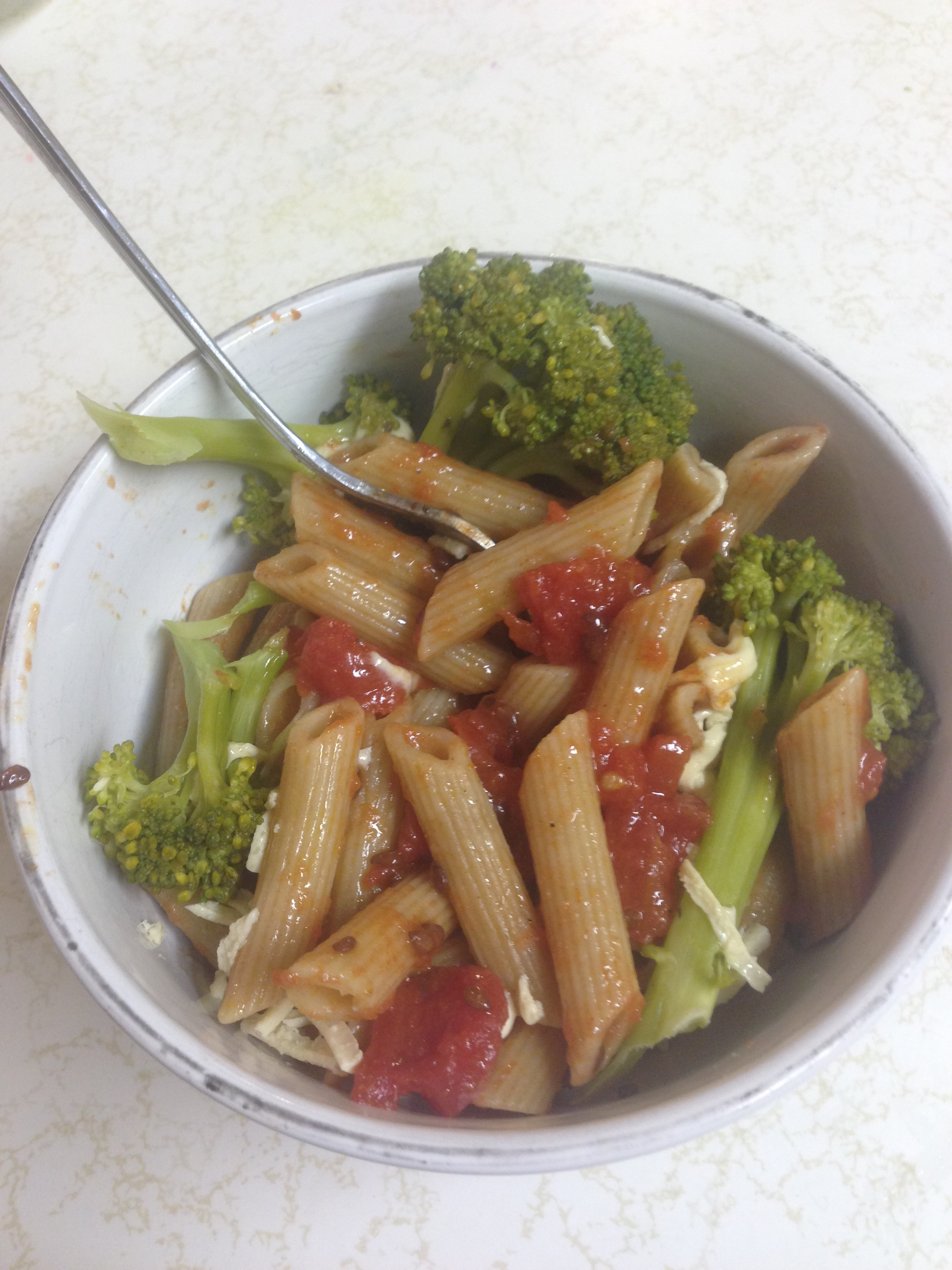 ... Pasta With Broccoli, Tomatoes And Pine Nuts Topped With Vegan Cheese